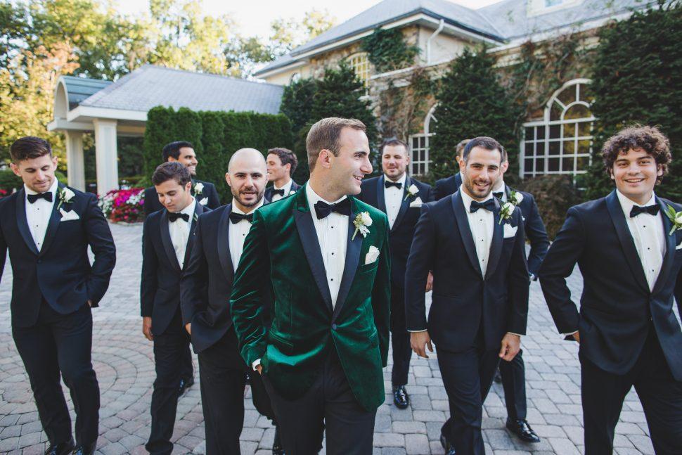 Groomsmen at a wedding having fun together