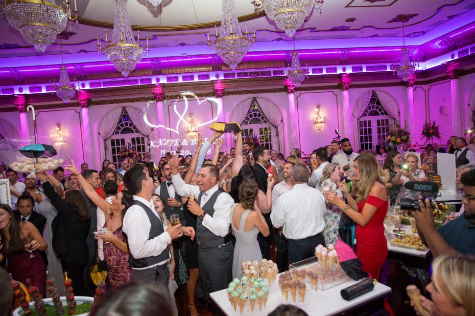 A group of young men and women party at a wedding in Livingston, New Jersey