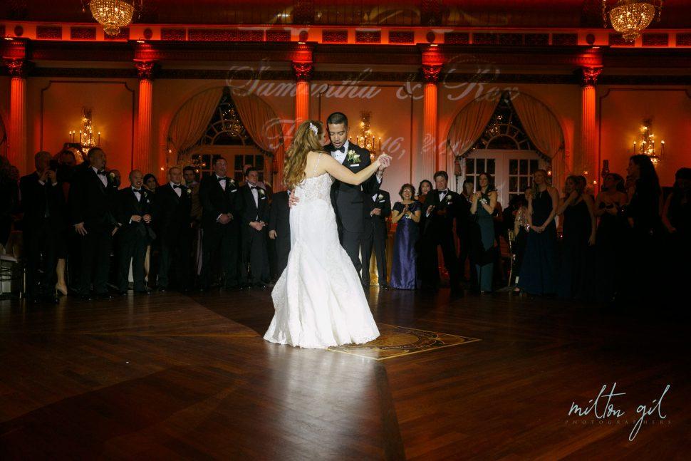 A bride & groom enjoying their first dance together in a beautiful ballroom