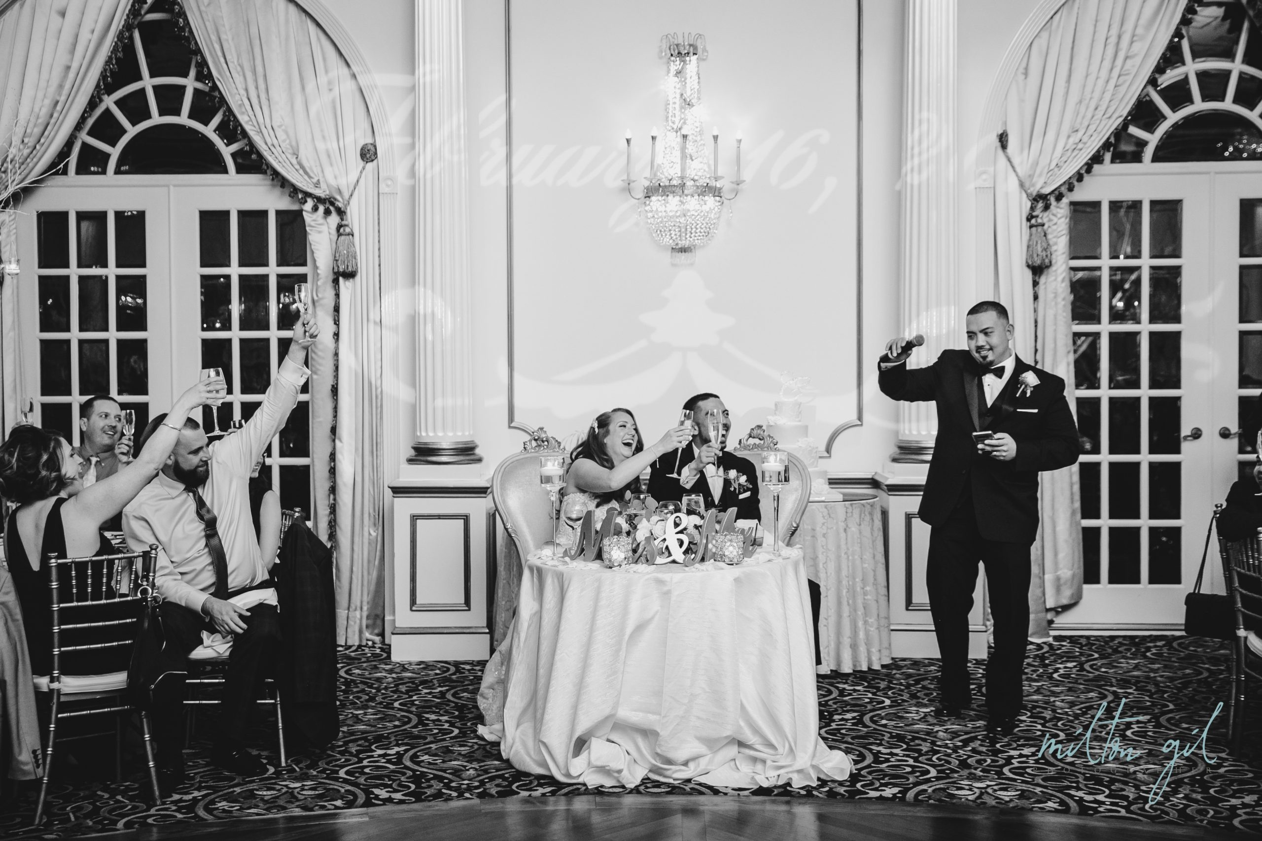 Best Man, Bride and Groom celebrating with guests at wedding in Livingston, New Jersey
