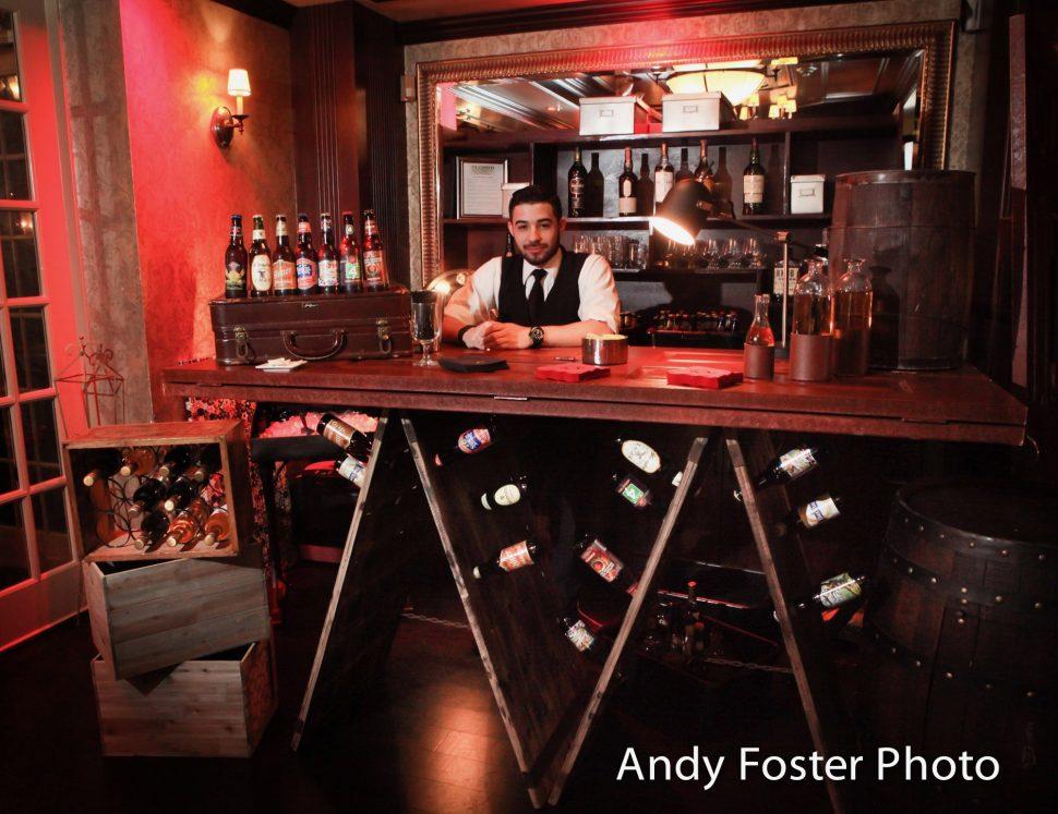 A barman at a wedding waiting to serve