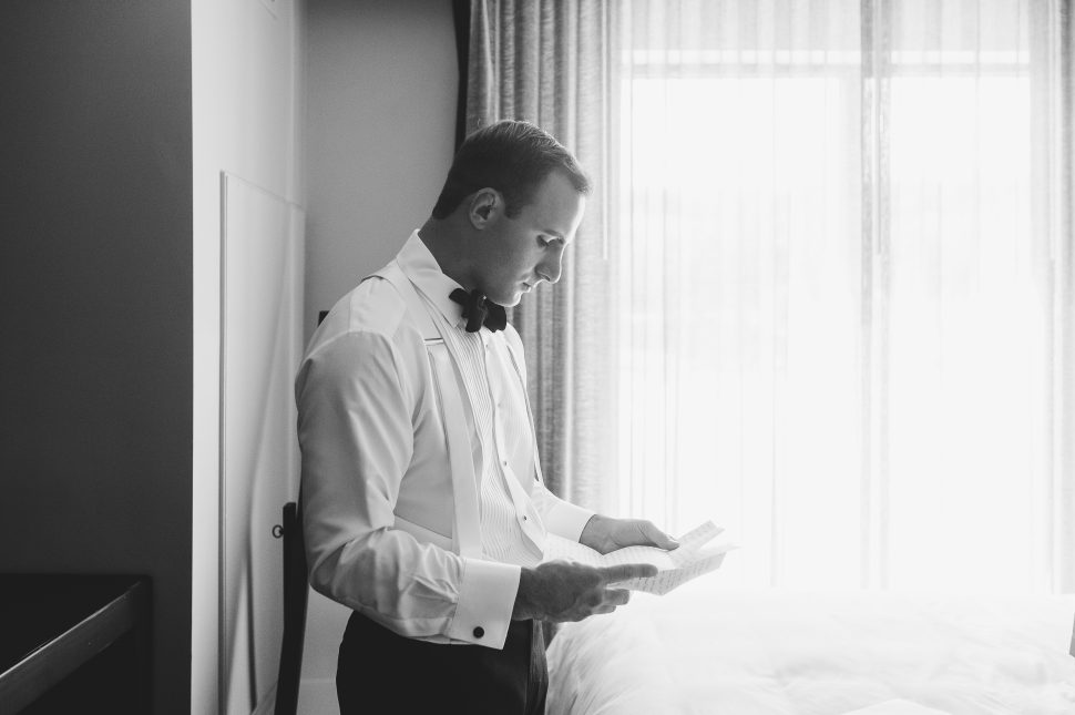 The groom reads a love letter from his wife on the morning of their wedding