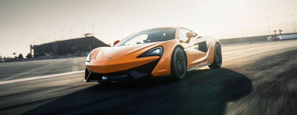 A McLaren 570S driving round a course