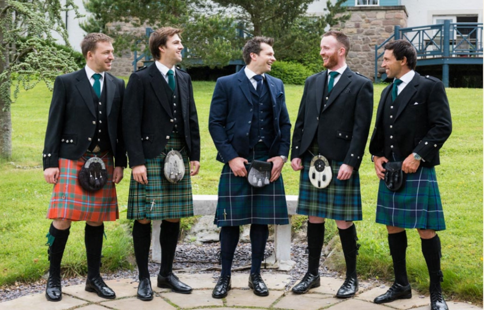 A group of men in kilts