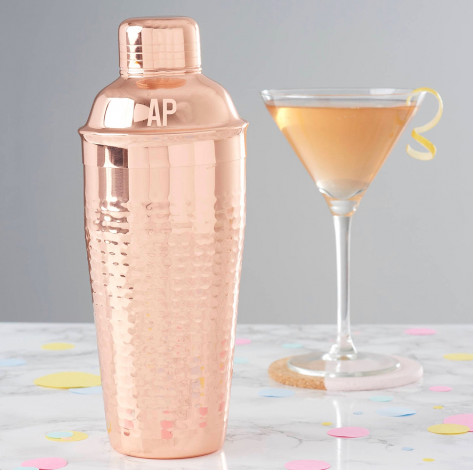 A cocktail shaker personalized with engraved letters for the bride & groom