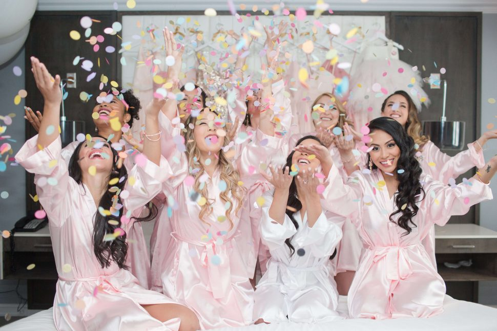 bridesmaids throwing confetti into the air