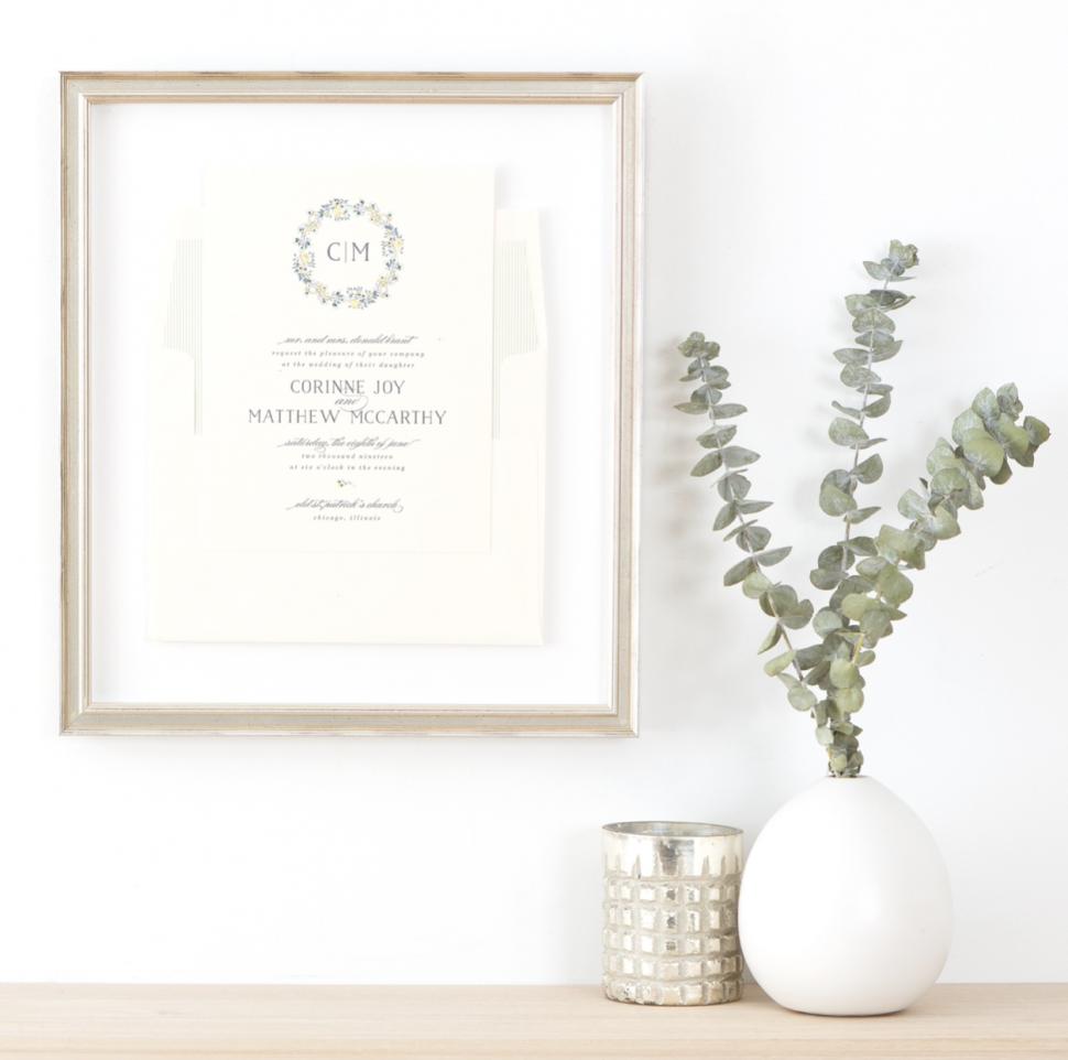 Framed wedding invitation hanging on a wall