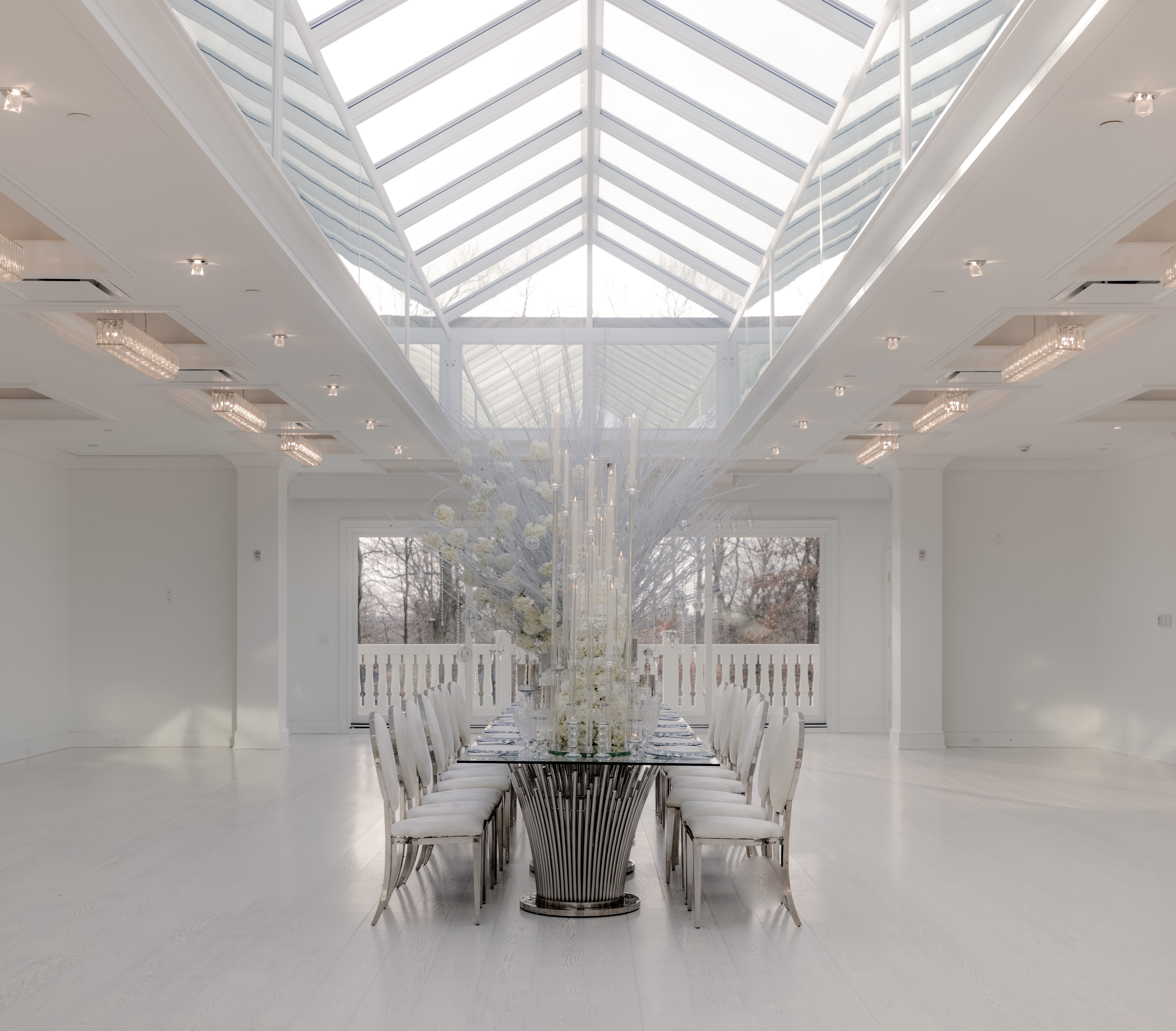 A beautiful table setting in the center of a natural lit Atrium at The Crystal Plaza wedding venue