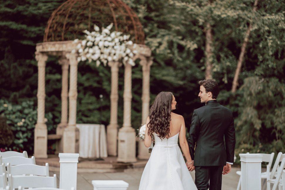 couple walks in garden